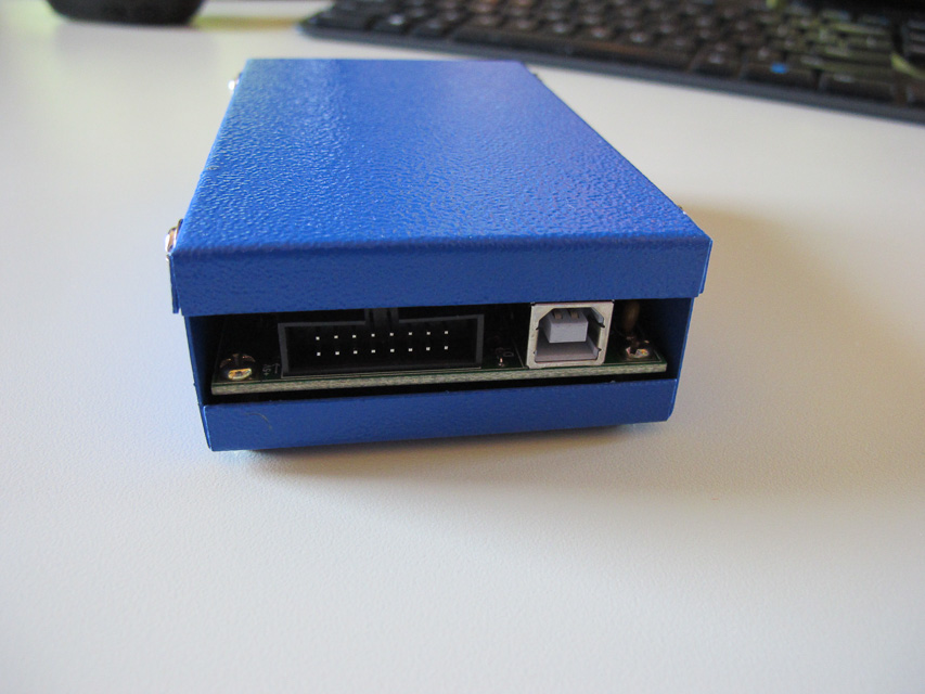 Image of the USB port end of the device. A USB and expansion port dominate this end.